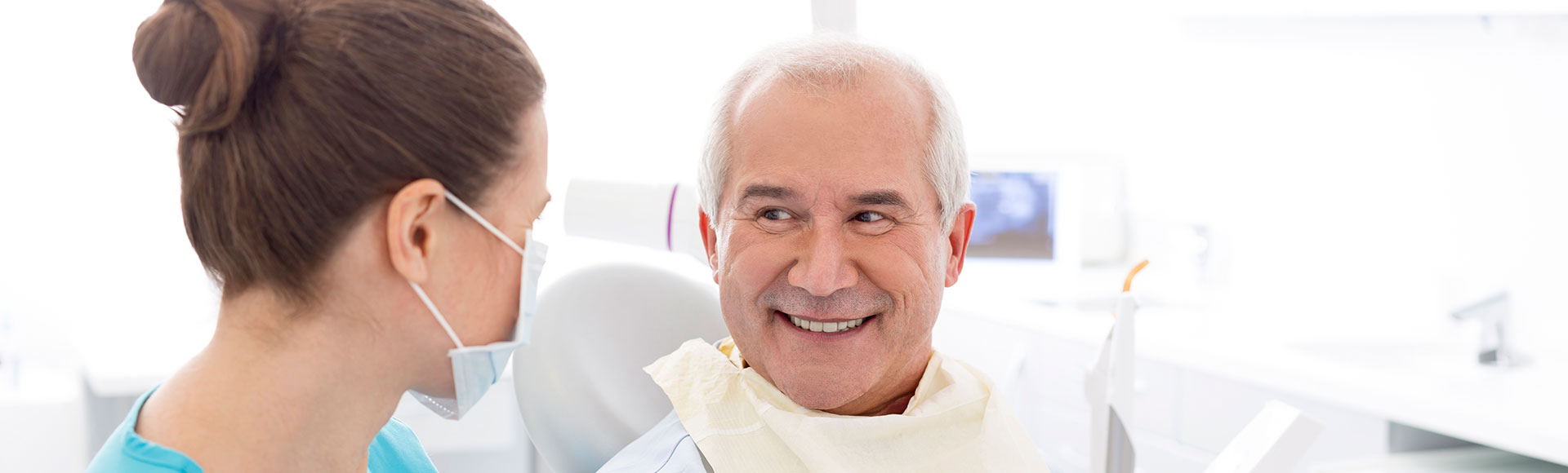 Older man smiling at hygentist